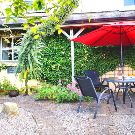 Doyle's Cottage Sunny Garden Warren Farm Cottages